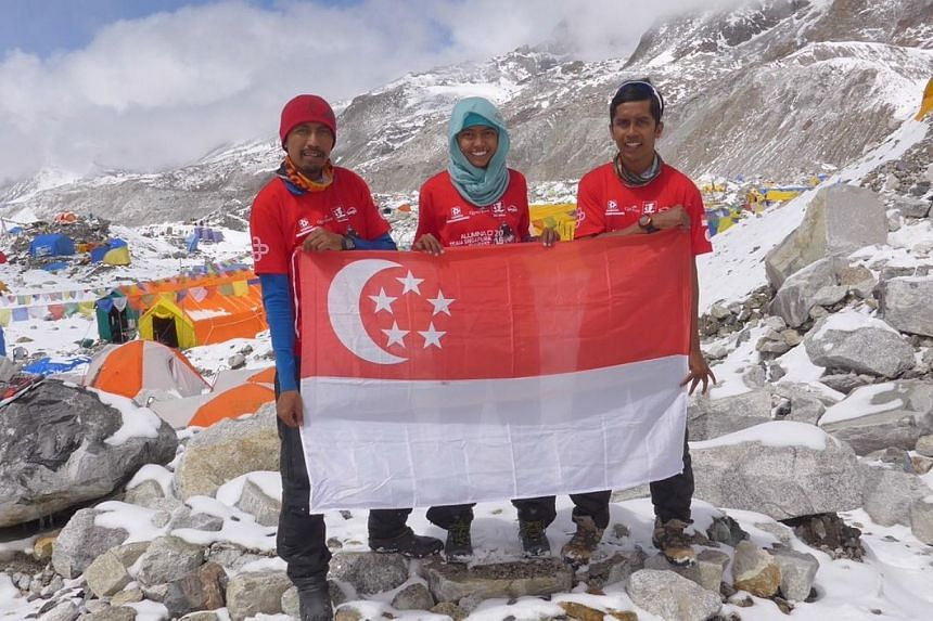 The three members from Aluminaid Team Singapore Everest 2015 are (from left) Mr Zulkifli Latiff, Ms Nur Yusrina Ya'akob and Mr Ismail Latiff, holding the Singapore flag at the Everest base Camp. Due to safety reasons, their expedition was called of