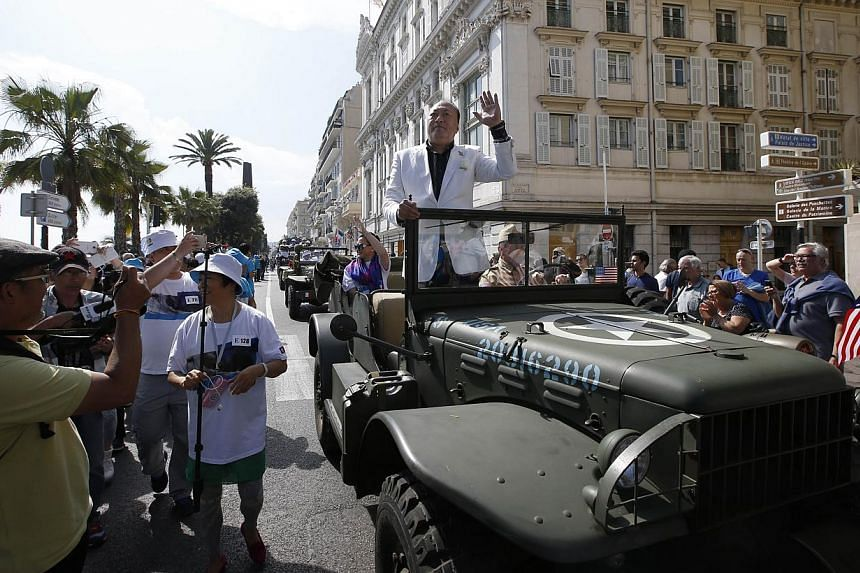 Li Jinyuan, chairman of Chinese company Tiens Group, parading in the French Riviera city of Nice. The company invited 6,400 of its employees to celebrate its 20th anniversary in France. -- PHOTO: AFP