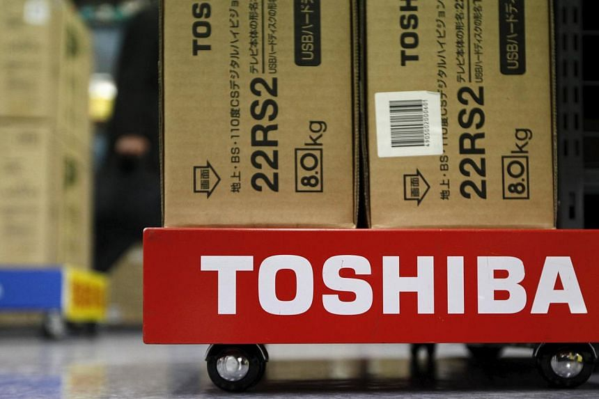 Toshiba shares plunged more than 16 per cent Monday after the Japanese conglomerate withdrew its earnings forecast and said it won't pay a dividend, citing a probe into accounting irregularities on infrastructure projects. -- PHOTO: REUTERS