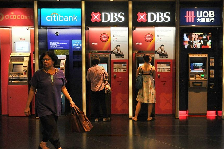 Individuals will be able to apply for and redeem Singapore Savings Bonds through DBS/POSB, OCBC or UOB ATMs, or via DBS/POSB internet banking channels, says the Monetary Authority of Singapore (MAS) on Monday. -- PHOTO: ST FILE