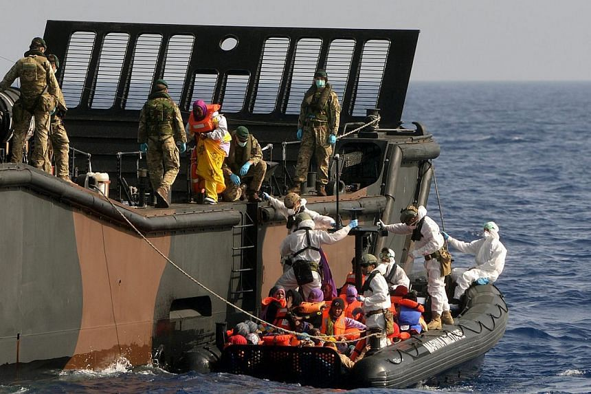 British Royal Navy personnel from HMS Bulwark helping rescued individuals onto a Royal Navy Landing Craft, in the Mediterranean Sea. Europe's first priority in confronting the Mediterranean migrant crisis is to save lives, EU foreign policy chief Fed