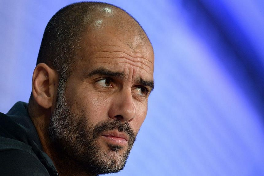 Bayern Munich's Spanish headcoach Pep Guardiola. He has dismissed out of hand rumours he will be quitting Bayern Munich with a year left on his contract to become Manchester City coach next season. -- PHOTO: AFP