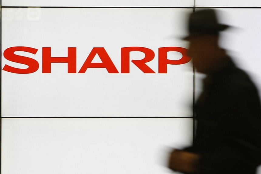 Shares in Japan's Sharp plunged 31 per cent on Monday after weekend media reports that the struggling electronics maker is planning a drastic capital reduction to help wipe away losses. -- PHOTO: REUTERS