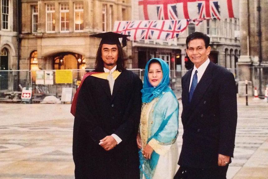 Art with his parents after graduating with a diploma in professional music development in London in 2003. -- PHOTO: COURTESY OF ART FAZIL