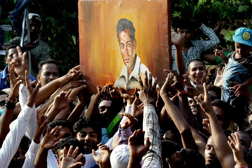 Fans celebrating outside Salman Khan's house in Galaxy Apartment after the superstar got bail in his hit-and-run case in Mumbai on Friday. Khan's five-year prison sentence was suspended pending an appeal. -- PHOTO: AGENCE FRANCE-PRESSE