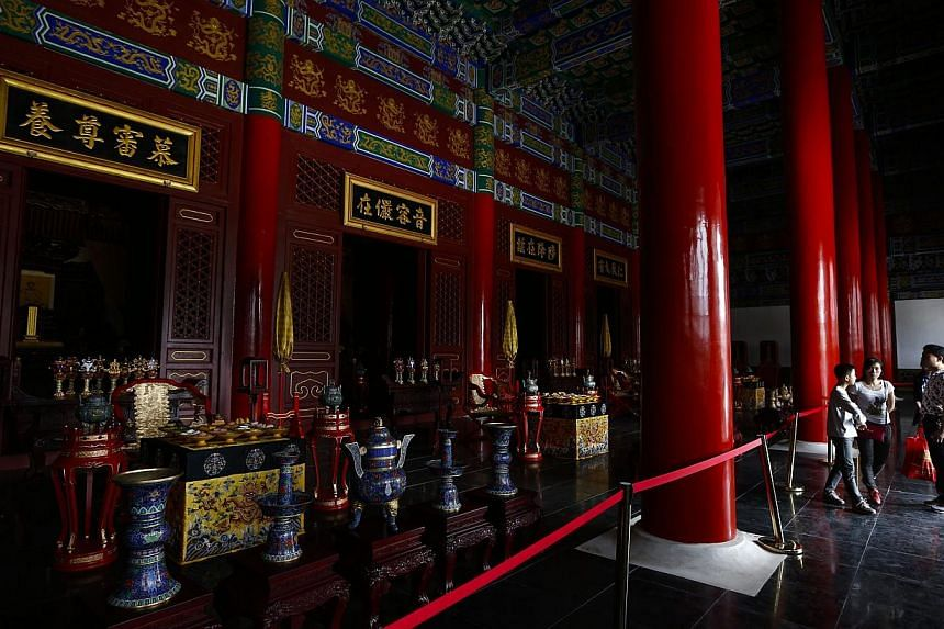 Tourists visit a scenic hall which is part of a replica of Beijing's Old Summer Palace or Yuanmingyuan, built in Hengdian town of Zhejiang province, eastern China on May 10, 2015. -- PHOTO: EPA