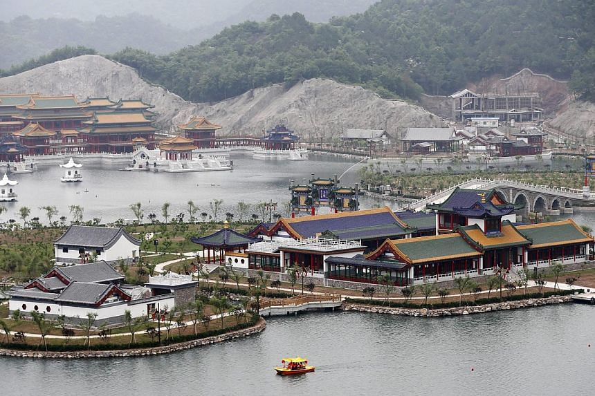 A general view of scenic areas which are part of a replica of Beijing's Old Summer Palace or Yuanmingyuan, built in Hengdian town of Zhejiang province, eastern China on May 10, 2015. -- PHOTO: EPA