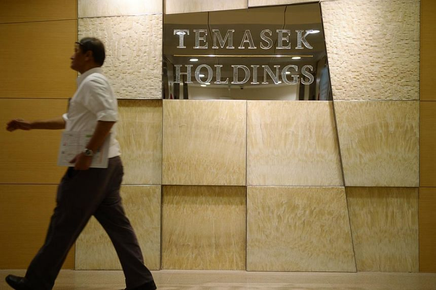 A man walks pass the Temasek Holdings office on Feb 16, 2015. A constitutional change was sought on Monday to make Temasek Holdings a bigger contributor to the Government's coffers, as Singapore prepares for more social and infrastructure spendi