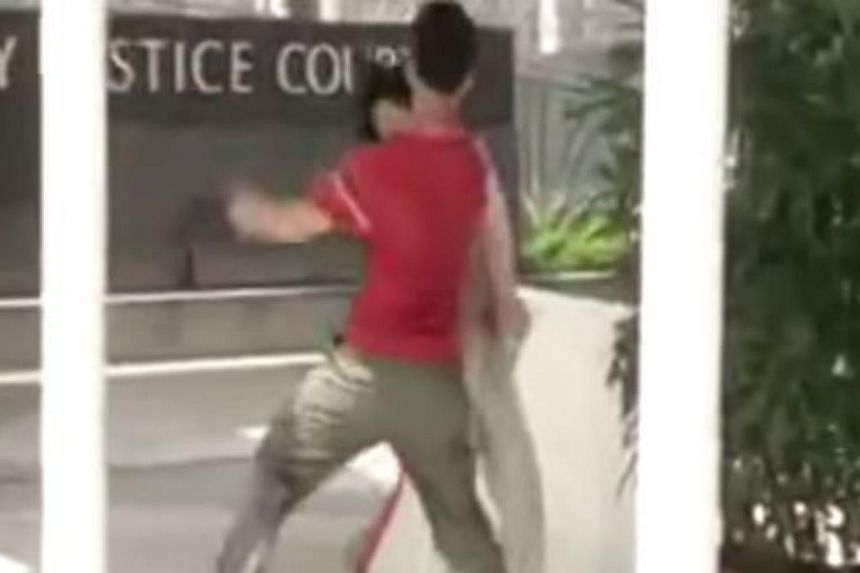 Neo, who is self-employed, was caught on camera slapping the teenagerat about 2.40pm on April 30, 2015. -- PHOTO: SCREENGRAB FROM YOUTUBE