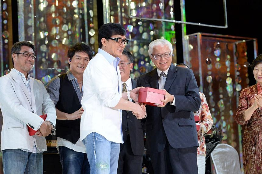 (From left) Celebrities Jonathan Lee, and Wakin Chau look on as Hong Kong star Jackie Chan receives a token of appreciation from President Tony Tan Keng Yam during the Love from the Stars gala. Mrs Mary Tan is on the right.The gala, held at Res