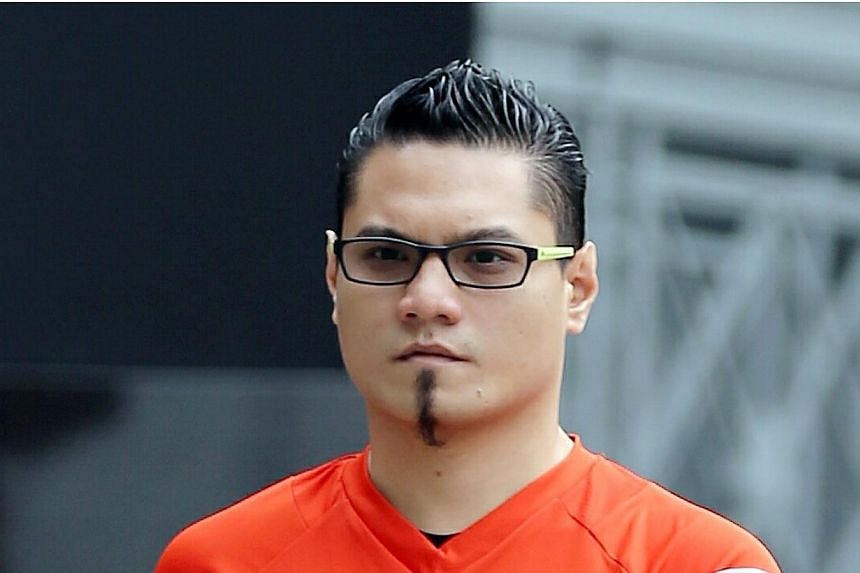 Train driver Muhamad Nizam Ahmad, 31, faced 16 charges in court and pleaded guilty to six of them. He had trespassed into other people's homes to molest women and commit theft. -- ST PHOTO: WONG KWAI CHOW