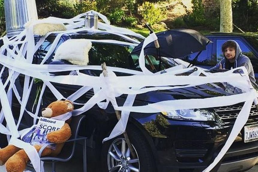 One Direction member Niall Horan's black Range Rover covered in a variety of items after a prank by bandmates Liam Payne and Louis Tomlinson. -- PHOTO: LIAM PAYNE/INSTAGRAM