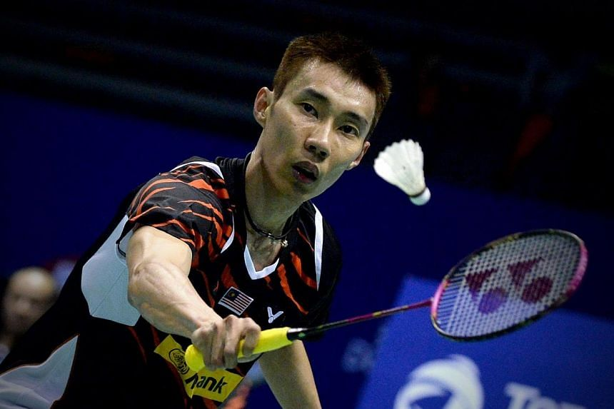 Lee Chong Wei of Malaysia returns to Dong Keun Lee of Korea during their men's singles match match of the 2015 Sudirman Cup world badminton championships in Dongguan, south China's Guangdong province on Sunday.-- PHOTO: AFP