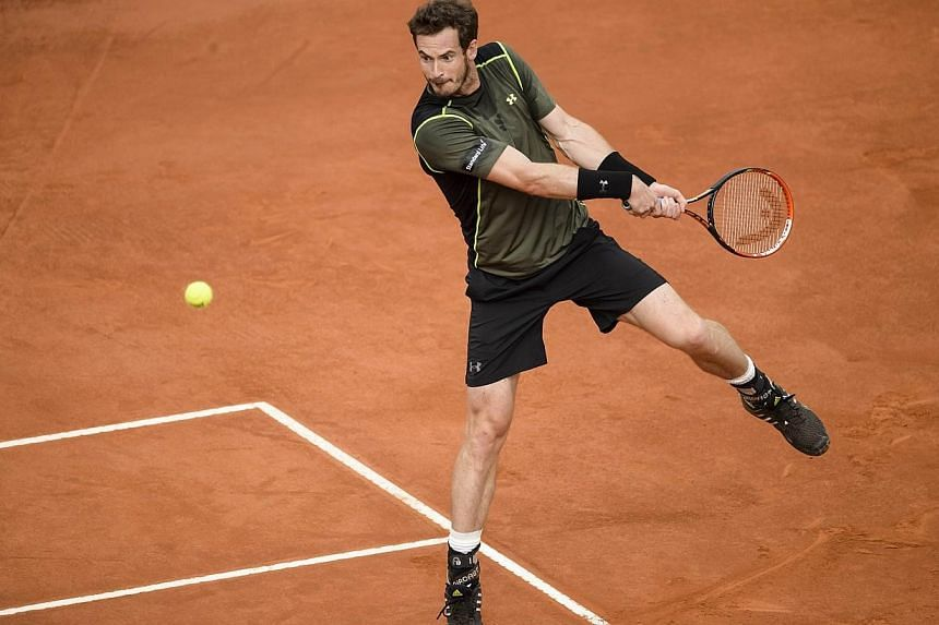 Andy Murray returns a ball to Spain's Rafael Nadal during the men final of Madrid Open tournament at the Caja Magica (Magic Box) sports complex in Madrid on Sunday. -- PHOTO: AFP