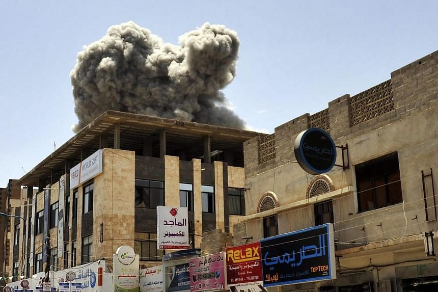 Smoke rises above the residence of former Yemeni President Ali Abdullah Saleh following an airstrike carried out by the Saudi-led alliance in Sana'a, Yemen on Sunday. -- PHOTO: EPA