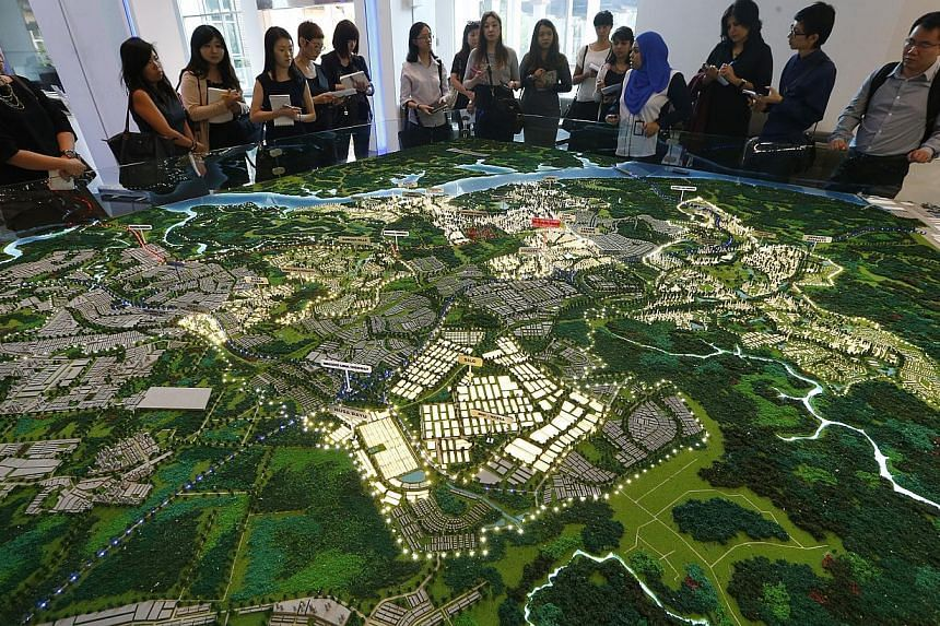 There are 336,000 new private residential units in the pipeline in the Iskandar development zone of southern Johor in Malaysia, more than the total number of private homes in Singapore. -- ST PHOTO:KEVIN LIM