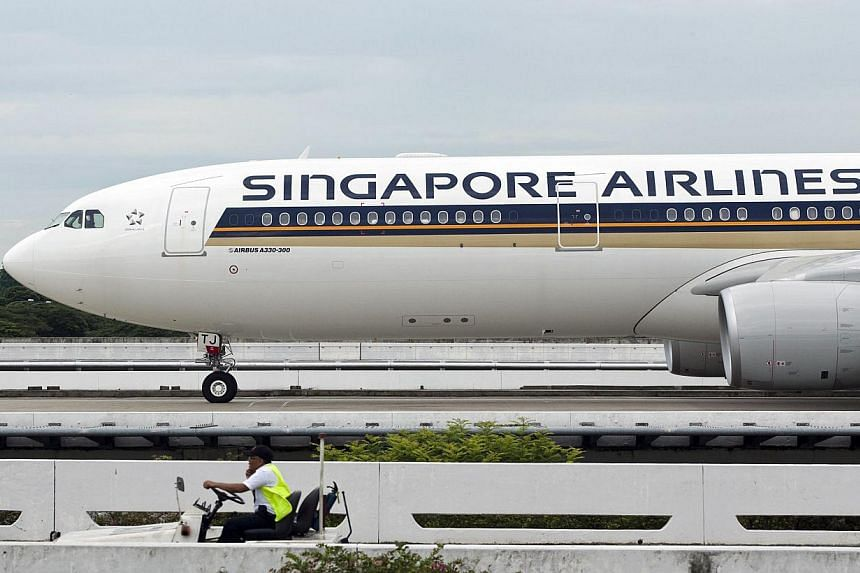 Singapore Airlines (SIA) has partnered the Singapore National Olympic Council (SNOC) as the official airline partner for Team Singapore until the end of April 2018 in the first such partnership of its kind. -- PHOTO: BLOOMBERG