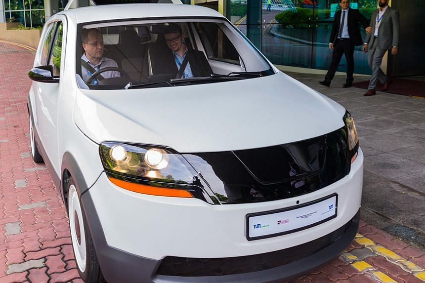 EVA, believed to be the world's first electric taxi designed in a collaboration between NTU and Germany's Technische Universität München, is said to be able to go some 200km on a single 15-minute charge. -- PHOTO: TUM CREATE