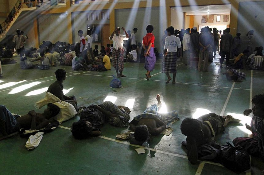 Migrants believed to be Rohingya are seen inside a shelter after being rescued from boats, in Lhoksukon, Indonesia's Aceh Province, on May 11, 2015. -- PHOTO: REUTERS