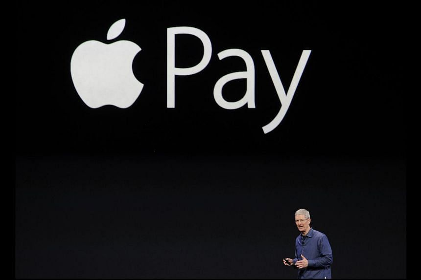 Apple Inc is in talks with Chinese banks and Alibaba Group on launching the firm's mobile payments system in China, Chief Executive Tim Cook told the official Xinhua news agency in an interview published on Tuesday. -- PHOTO: BLOOMBERG