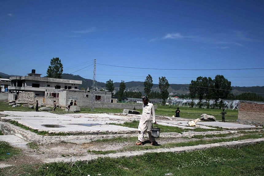A man passing by the demolished site in Abbottabad, Pakistan, where Osama bin Laden was killed, on May 1, 2015, the fourth anniversary of his death. The White House has flatly rejected claims that Pakistan was told in advance about the 2011 special o