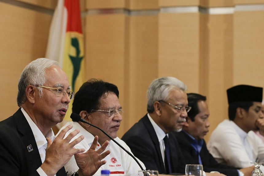 Malaysia's Prime Minister Najib Razak (left) speaks to members of the media during a news conference at Kuala Lumpur, Malaysia, on May 11, 2015. -- PHOTO: EPA