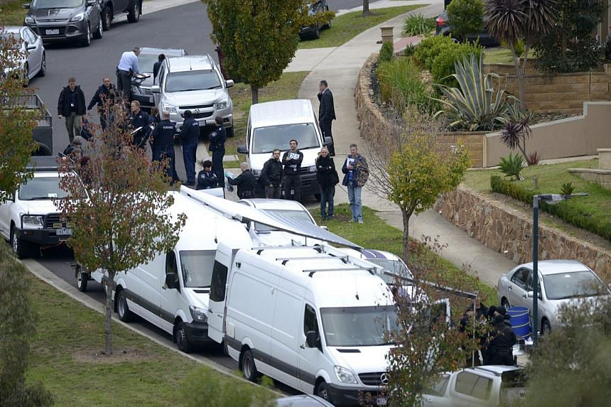 "Australian police conducting a terror raid in Greenvale, Melbourne, on May 8, 2015. The country will allocate an extra A$450 million (S$476 million) to fight home-grown terrorism and bolster intelligence agencies to counter ""evolving threats and tech"