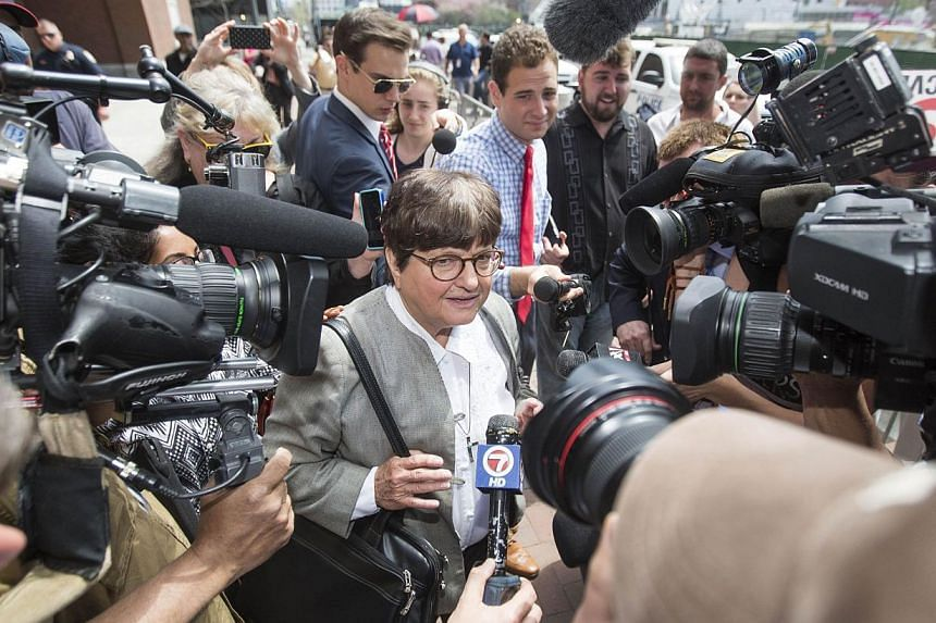 Sister Helen Prejean is surrounded by media after testifying at John Joseph Moakley United States Courthouse as the Tsarnaev defence nears its end of presenting case in sentencing phase of the Boston Bomber Trial on May 11, 2015. -- PHOTO: AFP