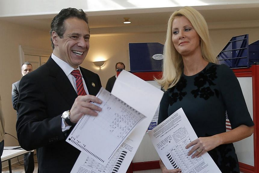 Democratic New York Governor Andrew Cuomo and his girlfriend Sandra Lee in a November 2014 file photo. The television chef girlfriend of New York Governor Andrew Cuomo on Tuesday became the latest American celebrity to announce she will undergo a dou