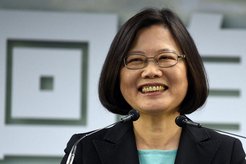 Tsai Ing-wen, chairwoman of Taiwan's main opposition Democratic Progressive Party (DPP), smiles during a press conference in Taipei on April 15, 2015. -- PHOTO: AFP