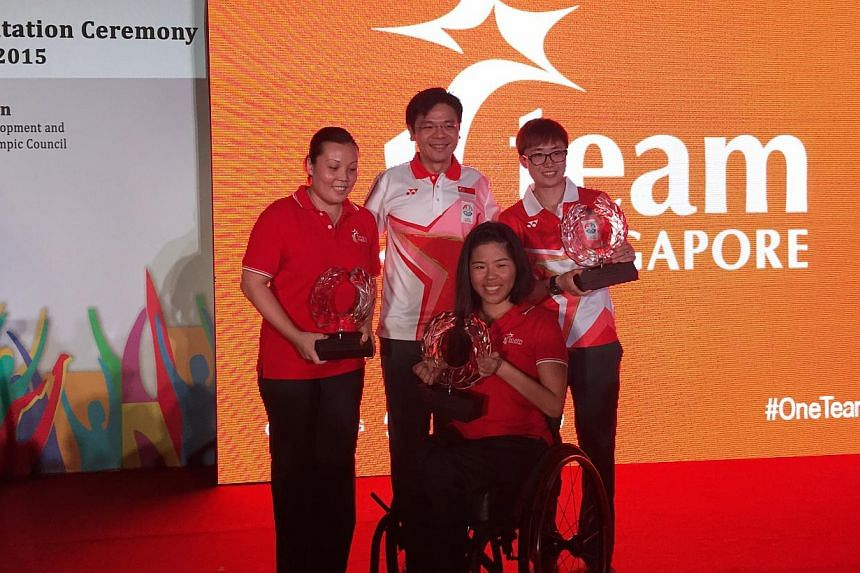 (From left) Wang Yuegu, Minister for Culture, Community and Youth Lawrence Wong, Yip Pin Xiu and Feng Tianwei. The athletes were inducted into the Sports Hall of Fame at the Team Singapore 28th SEA Games Flag Presentation Ceremony on Tuesday evening.
