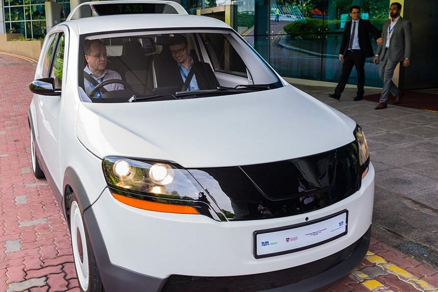 EVA, the taxi designed and built here by TUM Create - a collaboration between Nanyang Technological University and Germany's Technische Universitat Munchen - has a 200km range and a charging time of just 15 minutes. -- PHOTO: TUM CREATE