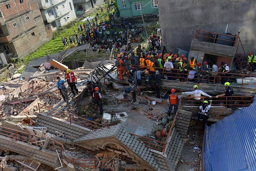 Rescue team officials searching for survivors at a collapsed building in Kathmandu on May 12, 2015. -- PHOTO: AFP