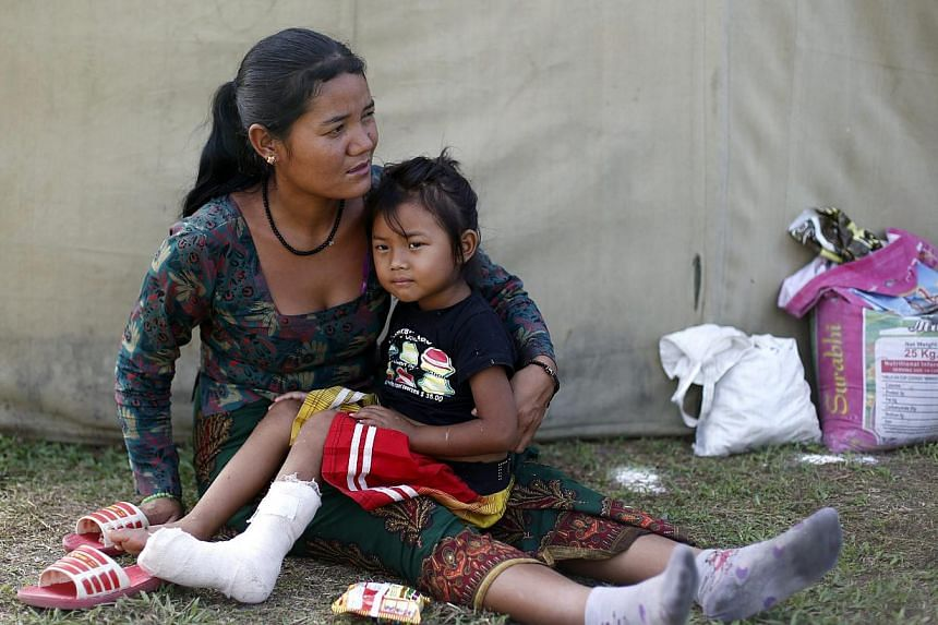 Nepalese earthquake survivors Monju Taman, 26, and her daughter Pasang Tamang, four, staying on open ground after another earthquake in Kathmandu, Nepal, on May 12, 2015. -- PHOTO: EPA