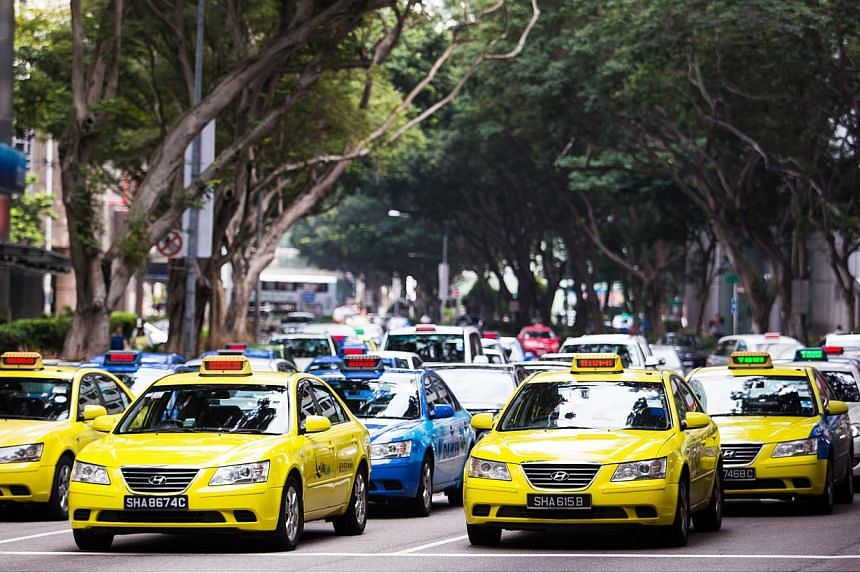 The Government this week stepped in to regulate the growing sector of third-party taxi booking services, promising to safeguard the interest of commuters while also allowing space for the nascent industry to innovate and expand. -- PHOTO: BLOOMBERG&n