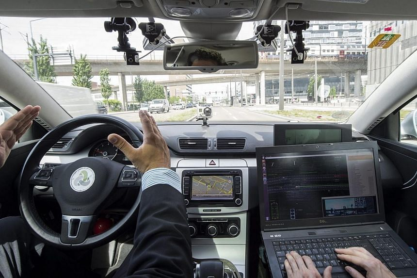 Tinosch Ganjineh (left) Project Leader AutoNOMOS, and Daniel Goehring, Project Leader Self-Driving Cars Intelligent Systems and Robotics Freie Universitaet Berlin (R) drive in a driverless car, presented by Swiss communication company Swisscom, durin