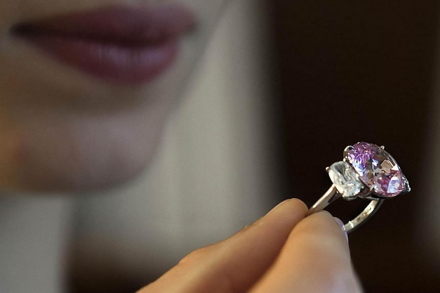 A 8.72-carat Fancy Vivid Pink diamond during a preview at auction house Sotheby's in Geneva. -- PHOTO: AFP