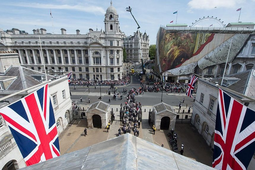 A handout photograph made available by the British Ministry of Defence showing a rooftop view from Horse Guards Parade of the VE Day Parade in central London, England, on May 10, 2015, after the service of Thanksgiving at Westminster Abbey. -- PHOTO: