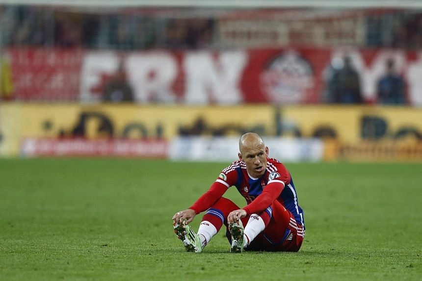 Bayern Munich's Arjen Robben sits on the pitch during their German Cup (DFB Pokal) semi-finalfootball match against Borussia Dortmund in Munich, Germanyon April 28, 2015. -- PHOTO: REUTERS