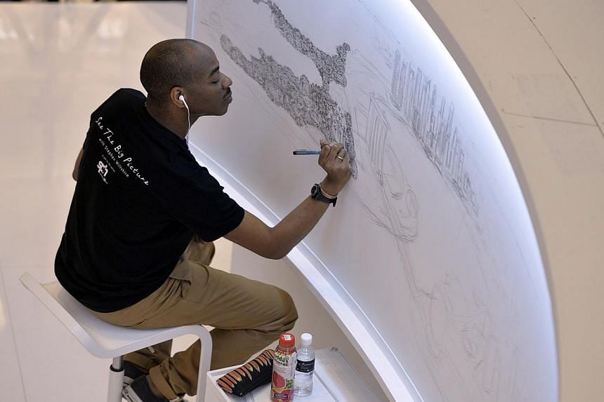 """The """"See the Big Picture"""" campaign organised by SPH and Germs Digital featured autistic savant Stephen Wiltshire, who drew Singapore's cityscape from memory at Paragon in July 2014. It attracted over 150,000 visitors in five days. -- PHOTO: SPH FILE"""