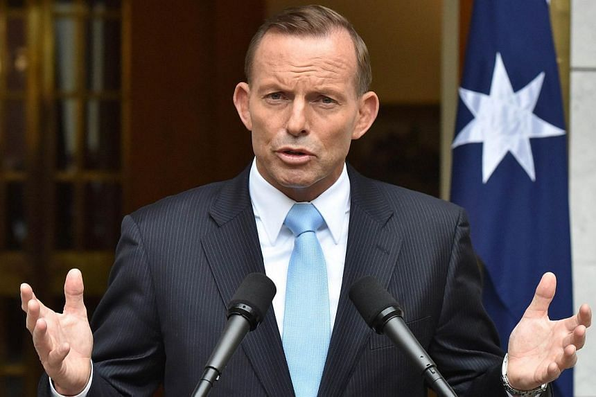 Australia's Prime Minister Tony Abbott speaking during a press conference after retaining the leadership of the Liberal party at Parliament House in Canberra on Feb 9, 2015. -- PHOTO: AFP