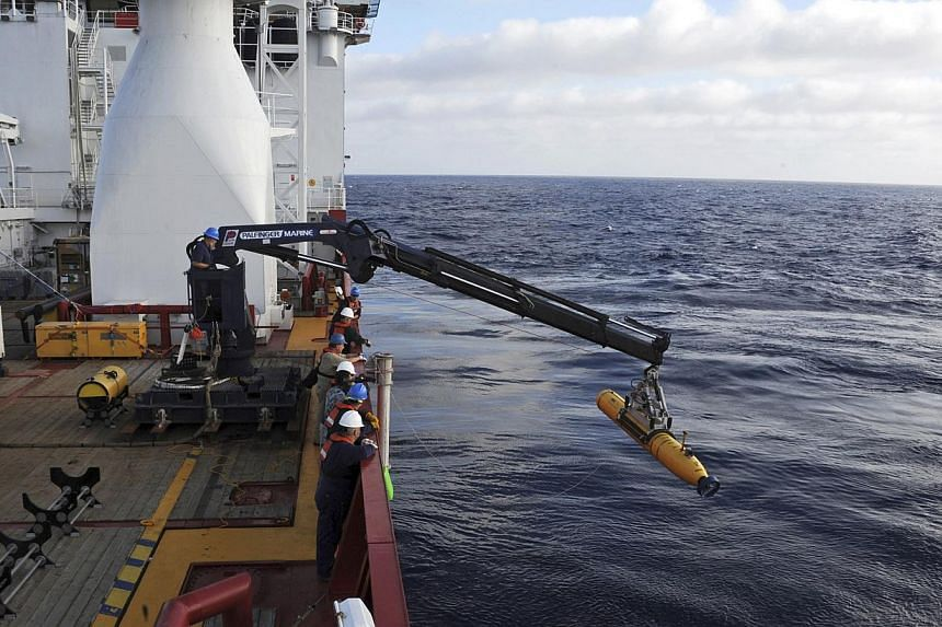 Operators aboard the Australian Defense Vessel Ocean Shield move the US Navy's Bluefin 21 autonomous underwater vehicle into position for deployment in the Southern Indian Ocean, as the search continues for the missing Malaysia Airlines Flight 370, i