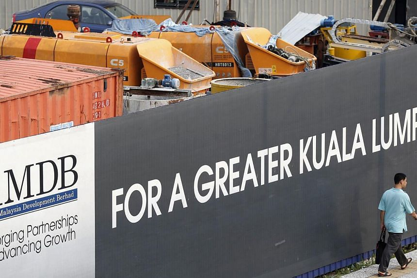 1Malaysia Development may make an early repayment of a US$975 million syndicated loan led by Deutsche Bank that the state investment company took out in September, according to people familiar with the matter. -- PHOTO: REUTERS