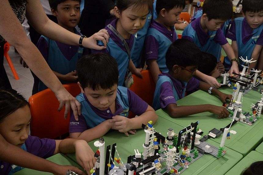 Students at West Spring Primary School combining their Lego creations during a Lego-based activity in class on May 13, 2015. -- ST PHOTO: MARK CHEONG