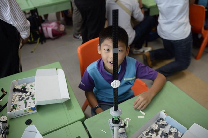 Student Nathaniel Chew showing off his Lego creation at West Spring Primary School during a Lego-based activity in class on May 13, 2015. -- ST PHOTO: MARK CHEONG