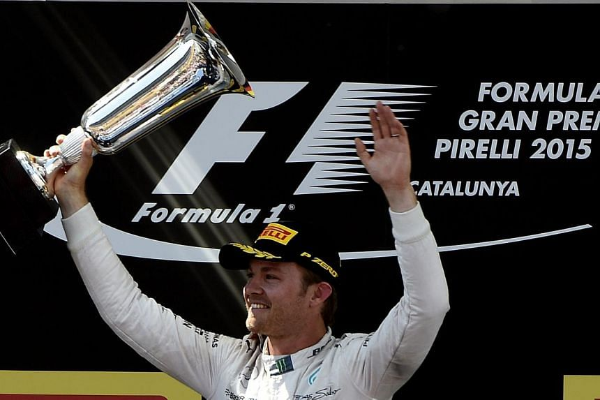 Mercedes AMG Petronas F1 Team's German driver Nico Rosberg celebrates on the podium after the Spanish Formula One Grand Prix on May 10, 2015 at the Circuit de Catalunya in Montmelo on the outskirts of Barcelona. -- PHOTO: AFP