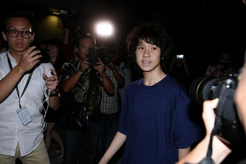 Amos Yee leaving the State Courts on May 12, 2015. The teenage blogger has alleged that he had been molested by his former bailor Vincent Law. -- ST PHOTO: WONG KWAI CHOW