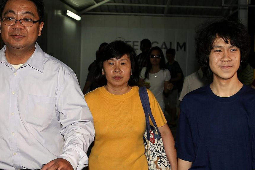 Amos Yee leaving the State Courts with his father Alphonsus Yee and mother Mary Toh yesterday. The teen was all smiles and took his time to ensure that the media got all the pictures it wanted.