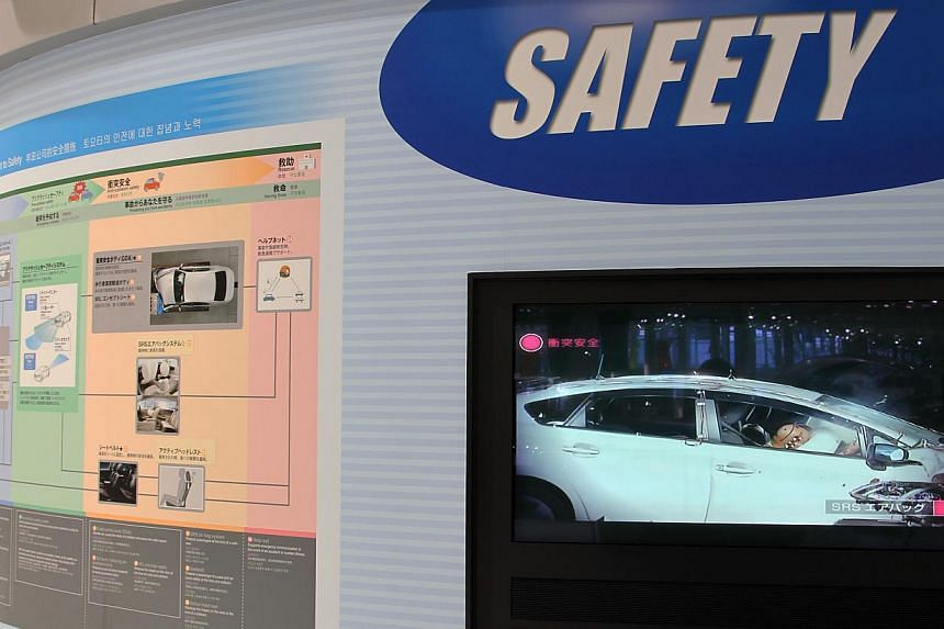 A screen displaying a video on airbag safety on Toyota vehicles at the company's showroom in Tokyo in 2013. Toyota and rival Nissan on Wednesday announced the recall of about 6.5 million vehicles globally in the latest chapter of an exploding airbag