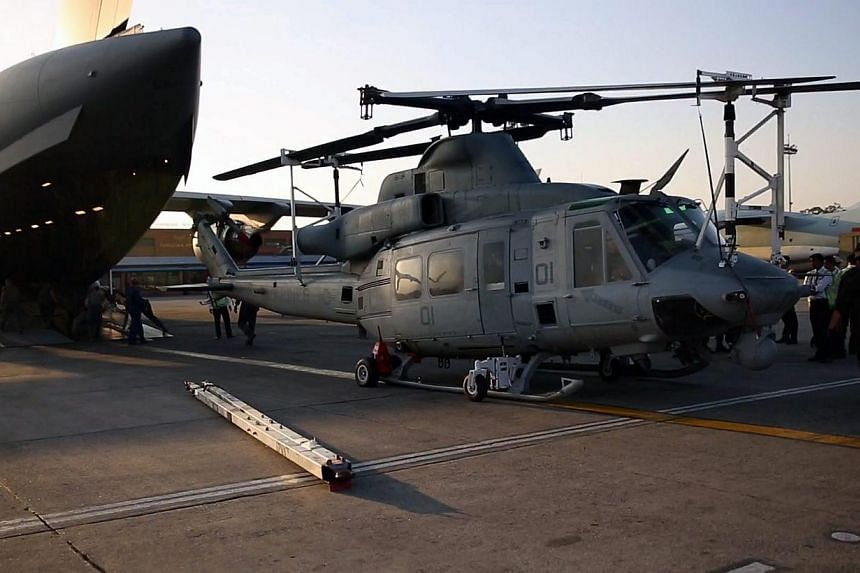 A handout picture shows US Marines at Tribhuvan International Airport in Kathmandu, Nepal, on May 3, 2015.A US Marine Corps helicopter involved in disaster relief efforts in Nepal was declared missing on Tuesday while working in the vicinity of